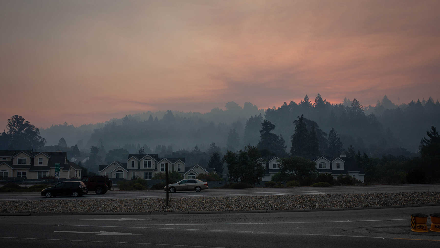 Smoke hangs over the city of Scotts Valley, California, in the Santa Cruz Mountains on Aug. 20, 2020. A series of fires, called the CZU Lightning Complex, have led to the evacuation of approximately 77,000 people from several mountain communities, including Scotts Valley, Boulder Creek and Bonny Doon. (Anna Maria Barry-Jester/KHN)