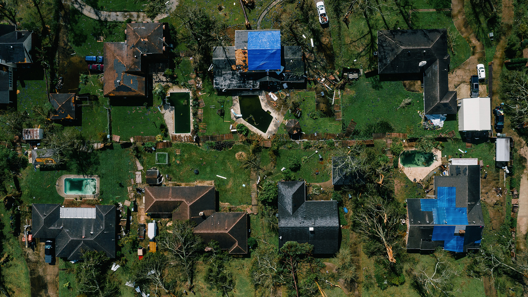 Downed trees near houses damaged after Hurricane Laura made landfall in this aerial photograph taken over Lake Charles, Louisiana, on Friday, Aug. 28, 2020. (Bryan Tarnowski/Bloomberg)
