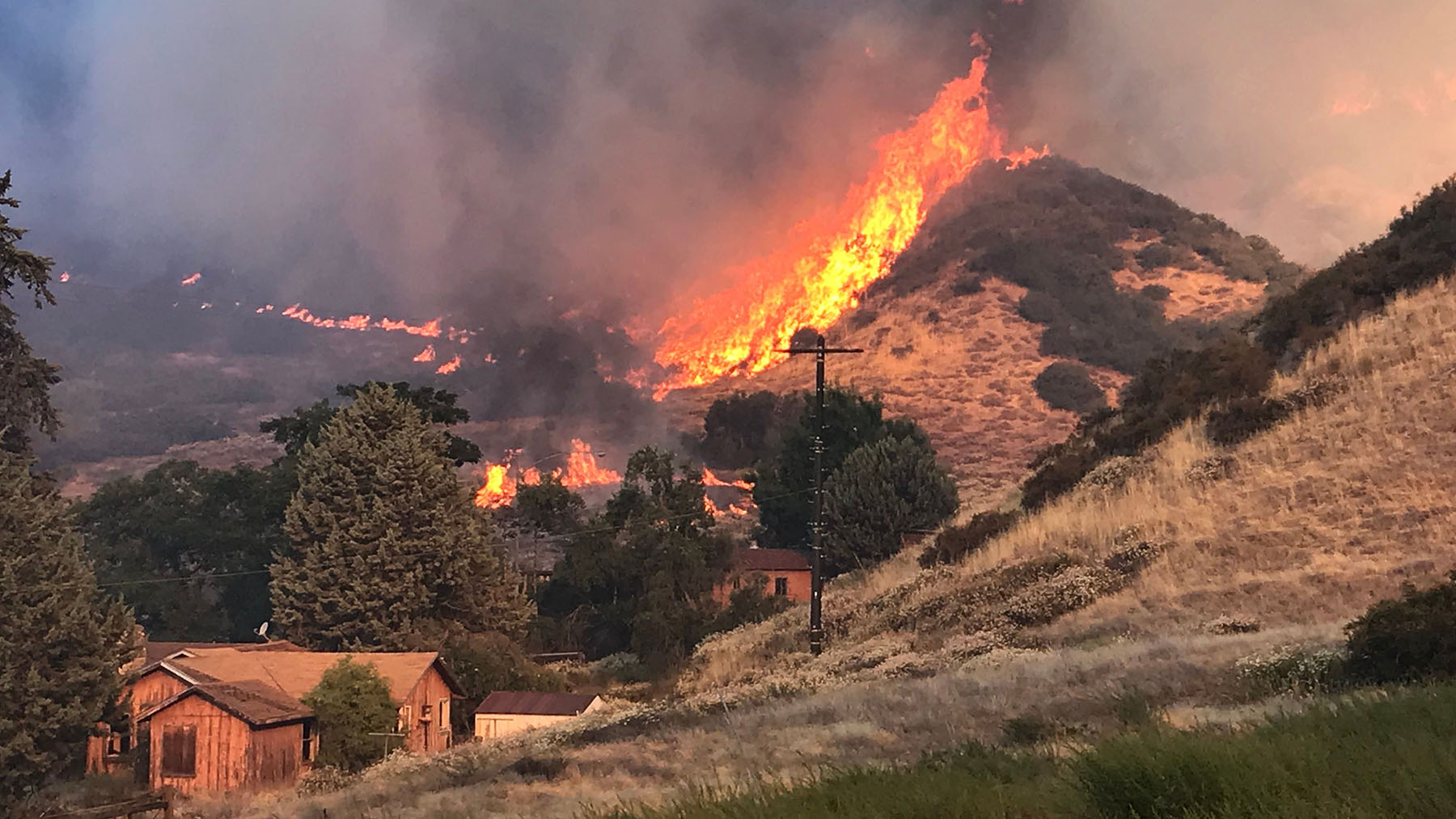 Flames burn through a canyon as part of the Apple Fire on August 2, 2020. Firefighters are working to contain the blaze in Riverside County. (Photo courtesy of the San Bernardino Fire Department)