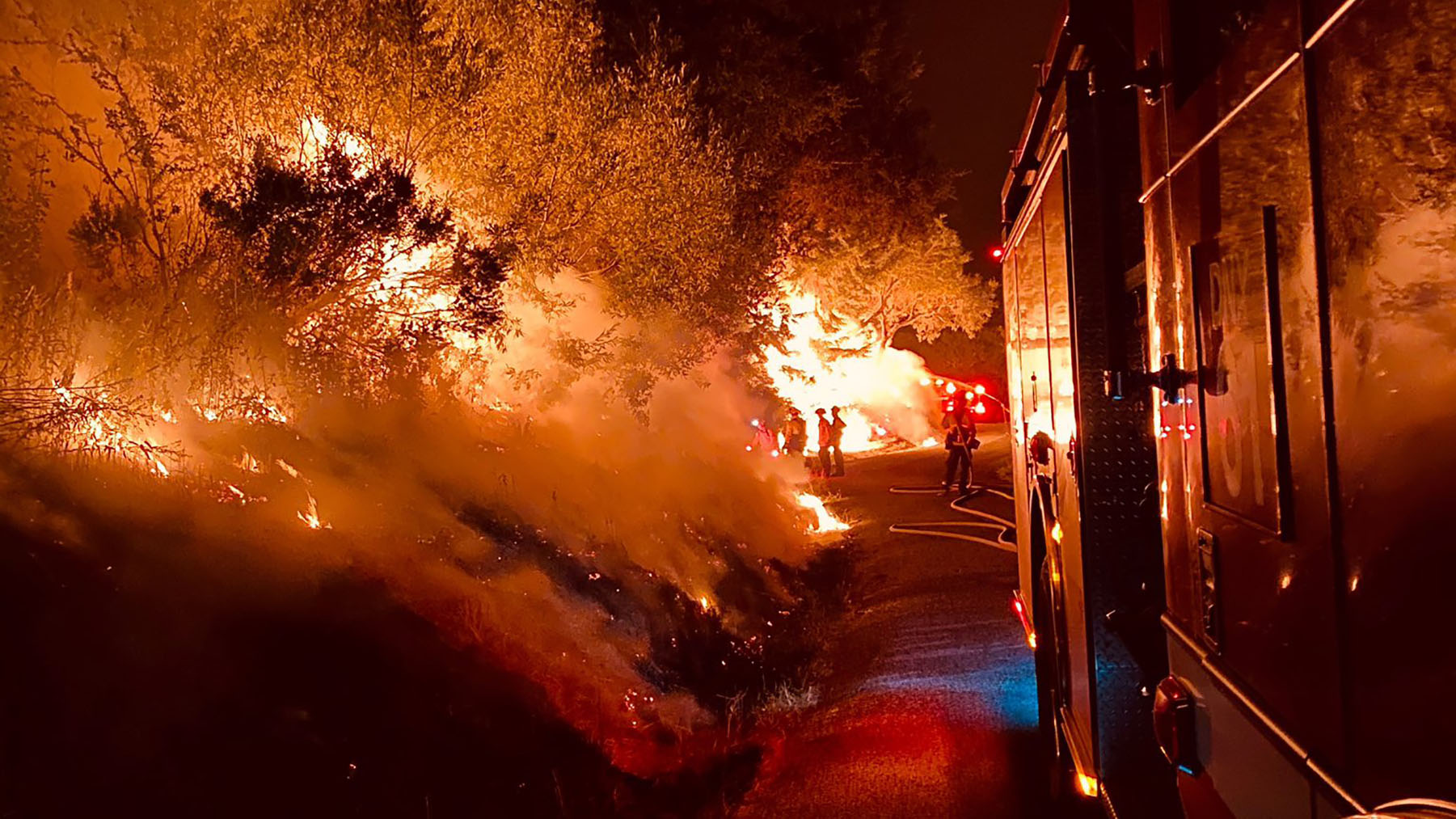 Fires burn in San Mateo County, California, on August 24, 2020. Widespread fire activity is continuing, with resulting poor air quality impacting much of Northern California. (CalFire photo)