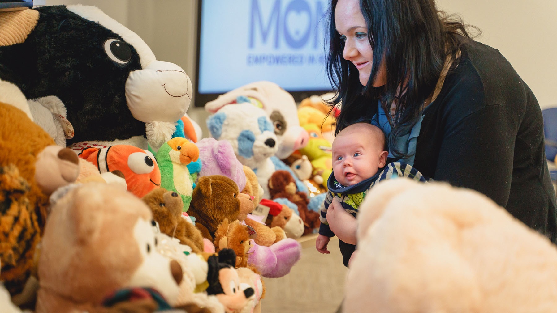 A new mom and her baby attend an event at the Wright Center for Community Health. The health center's Healthy MOMS program supports women addressing opioid dependency during pregnancy. (Photo courtesy of the Wright Center)