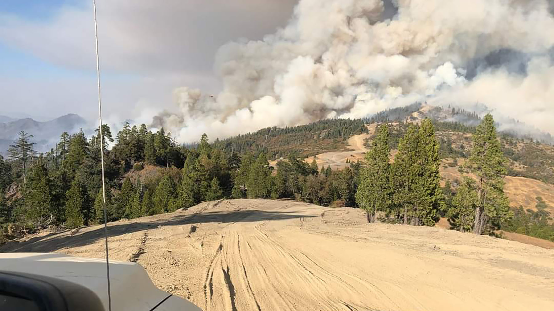The view from a Mendocino County Sheriff's vehicle shows the billowing smoke of the August Complex Fire on the Trinity County line in Northern California on Oct. 3, 2020. The fire is one of a dozen burning across California, impacting air quality and displacing residents. (Photo courtesy of the Mendocino County Sheriff's Department)