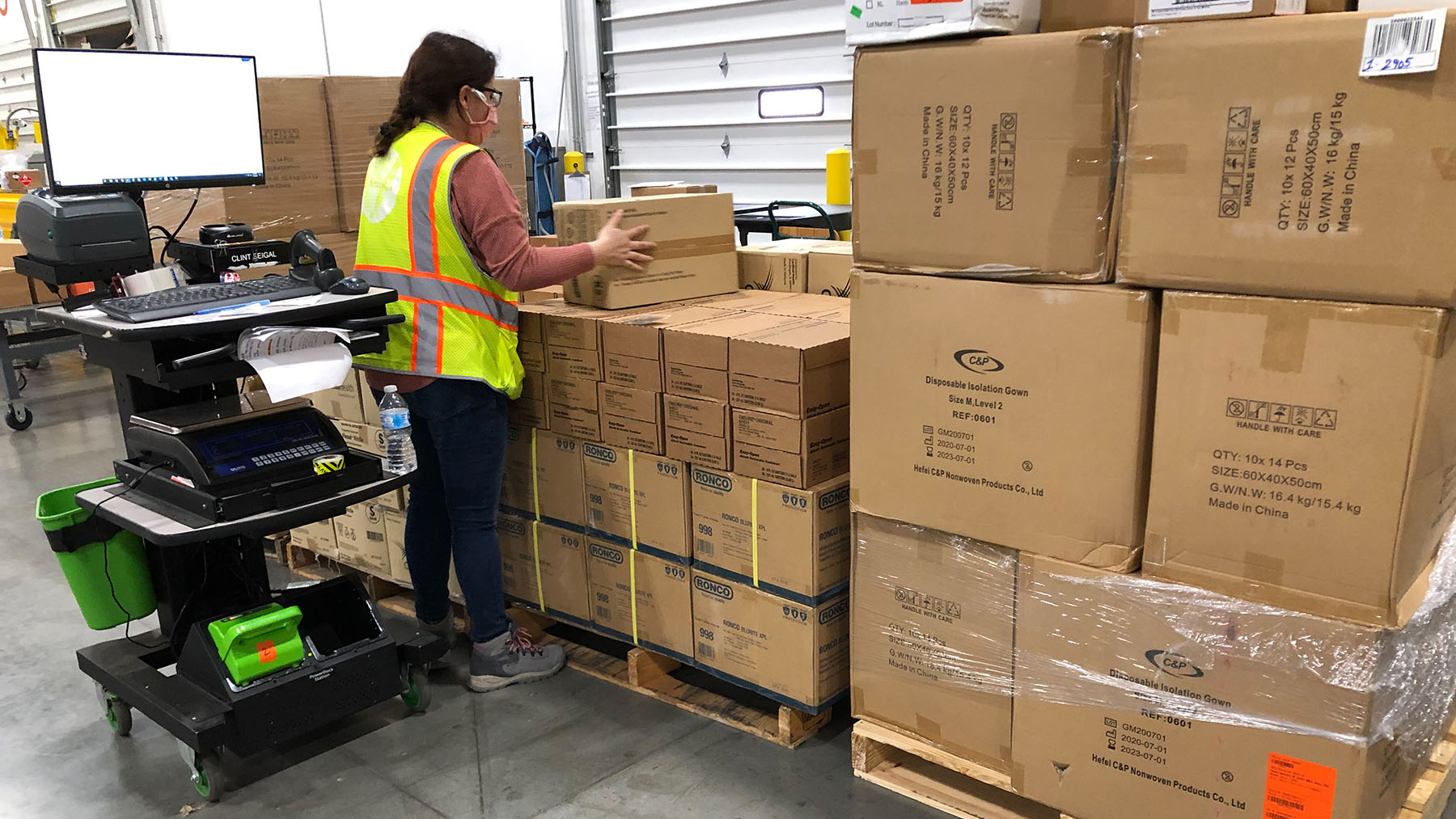 Protective gear, including isolation gowns and gloves, is staged for shipment in Direct Relief's warehouse on Nov. 5, 2020. Health facilities across the U.S. have continued requesting PPE and other medical essentials as Covid-19 cases spike. (Maeve O'Connor/Direct Relief)