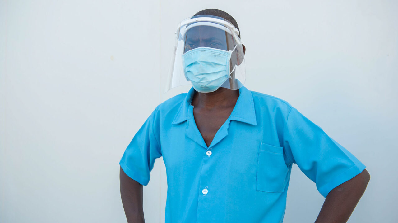 Health worker Reuben Chipelesa of Nkhunga Health Centre in Malawi wears donated PPE from the Covid-19 Action Fund for Africa. (Photo courtesy of Homeline Media)