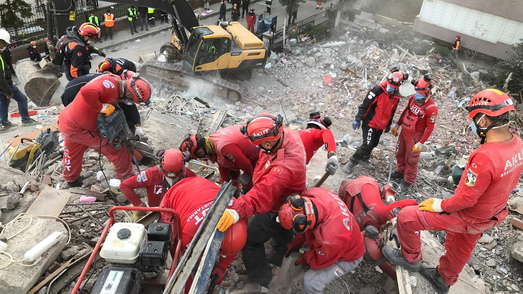 An AKUT search-and-rescue team works in the ruins of a building destroyed by the October 30 earthquake. (Photo courtesy of AKUT)