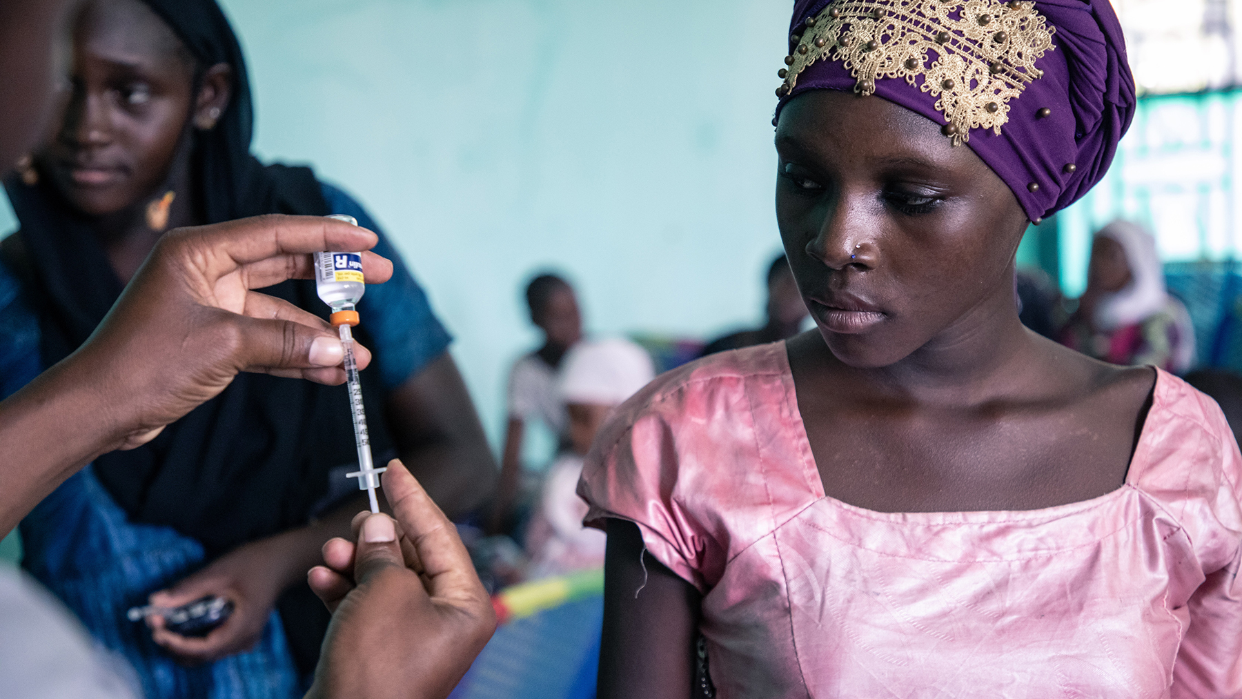 A young woman watches as a syringe is prepared during a diabetes education day in Bamako, Mali, pre-Covid. (Photo courtesy of Life for a Child)