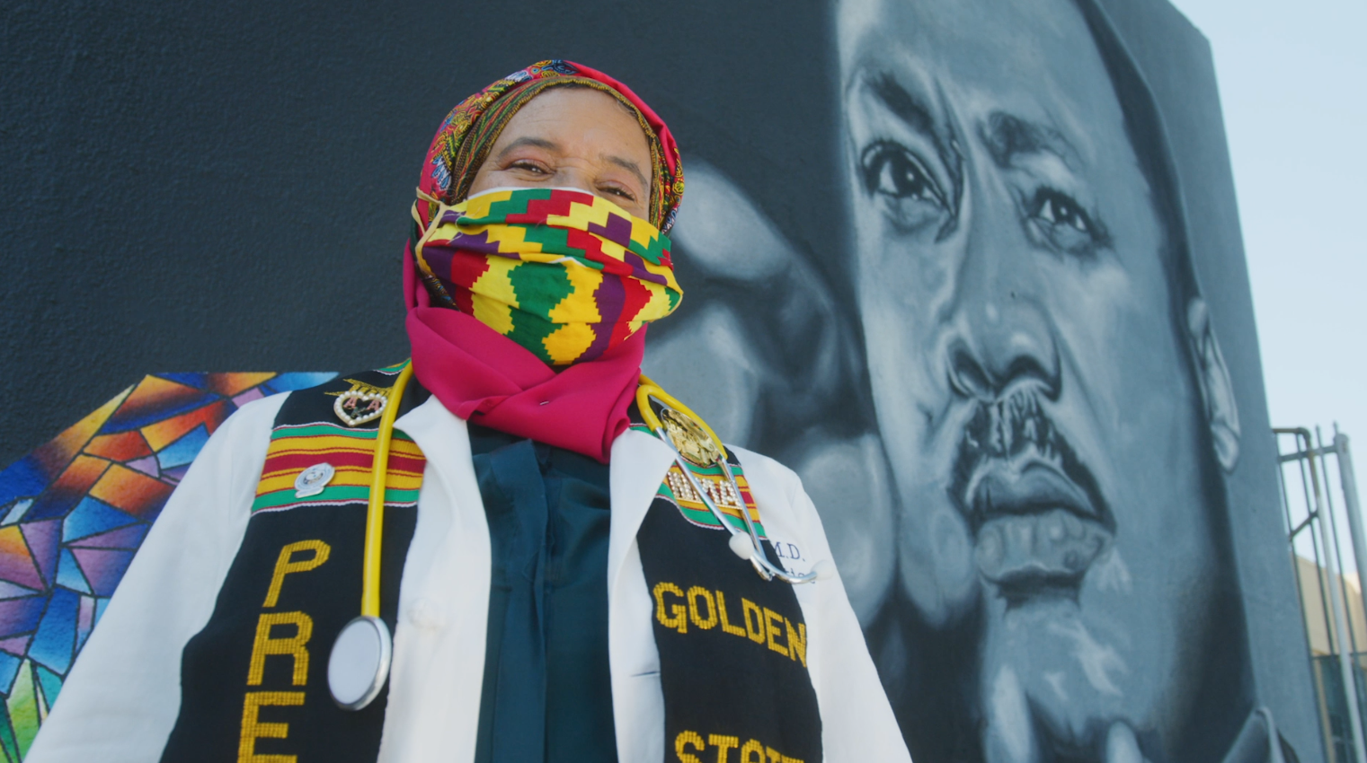 Dr. Khadijah Lang, president of the Golden State Medical Association, stands in front of a mural of Dr. Martin Luther King Jr. in Los Angeles. (Direct Relief)