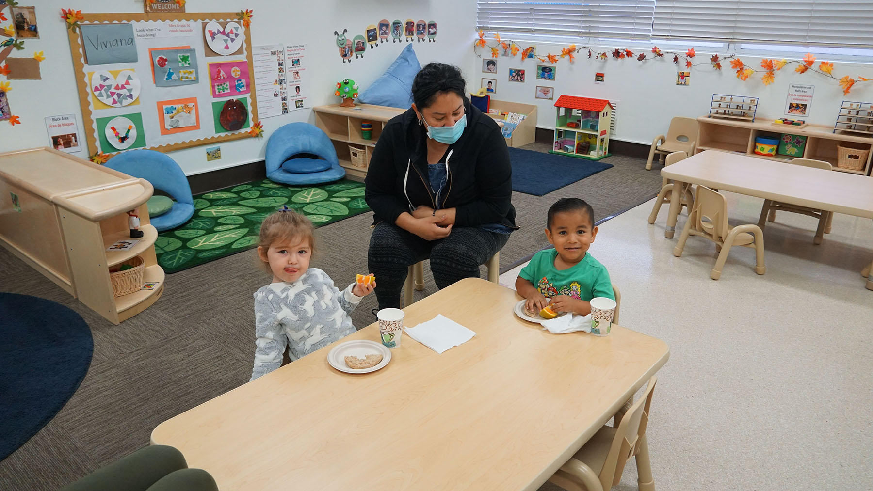 Children break for snack time at Venice Family Clinic in Los Angeles, Ca. The health center runs an early head start program for newborns to children up to three years of age. (Photo Courtesy of Venice Family Clinic)