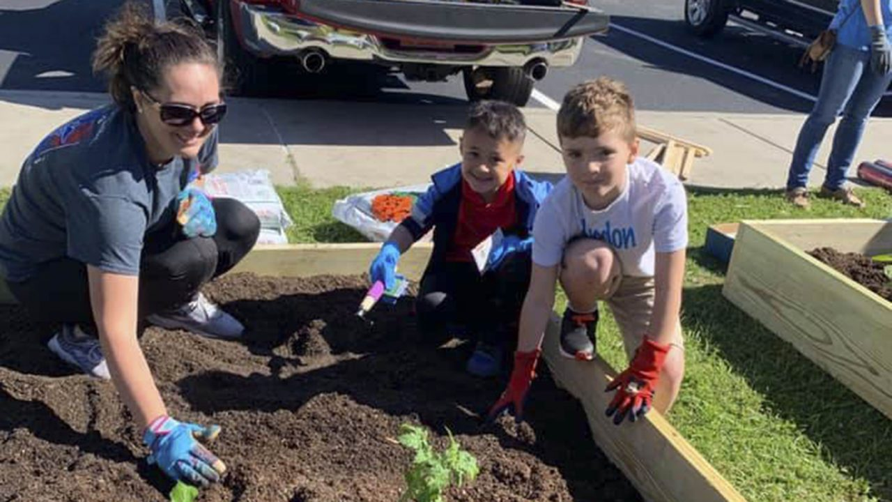 Young gardeners pose at Coastal Family Health Center's children's garden. (Photo courtesy of Coastal Family Health Center)