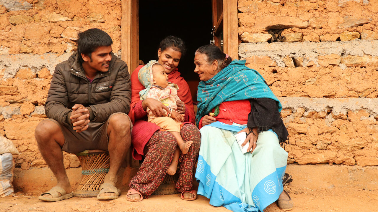 A Nepali family plays with their child. (Photo courtesy of One Heart Worldwide)