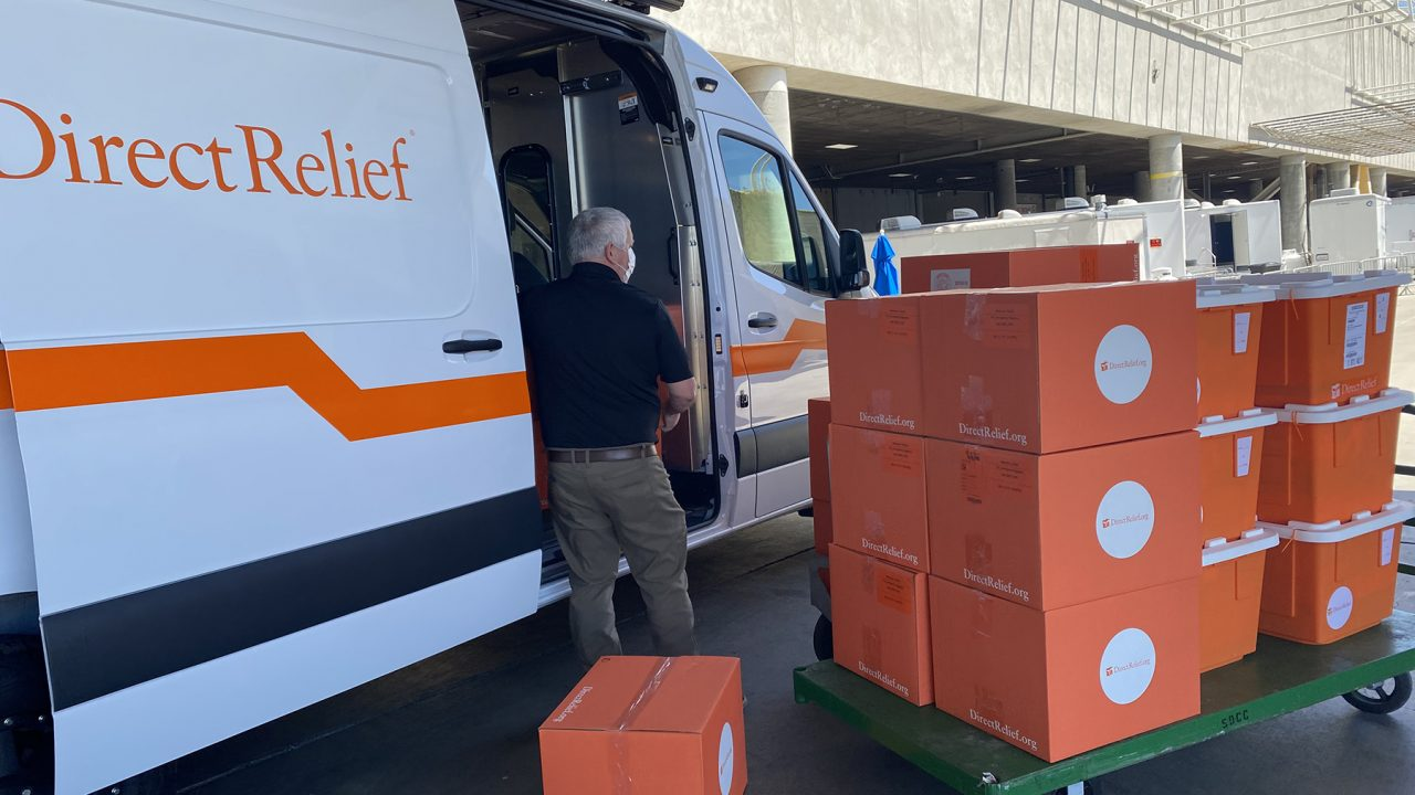 A Direct Relief staff member unloads medical aid in San Diego where thousands of migrant children will receive medical care and shelter. (Martin Calderon/Direct Relief)