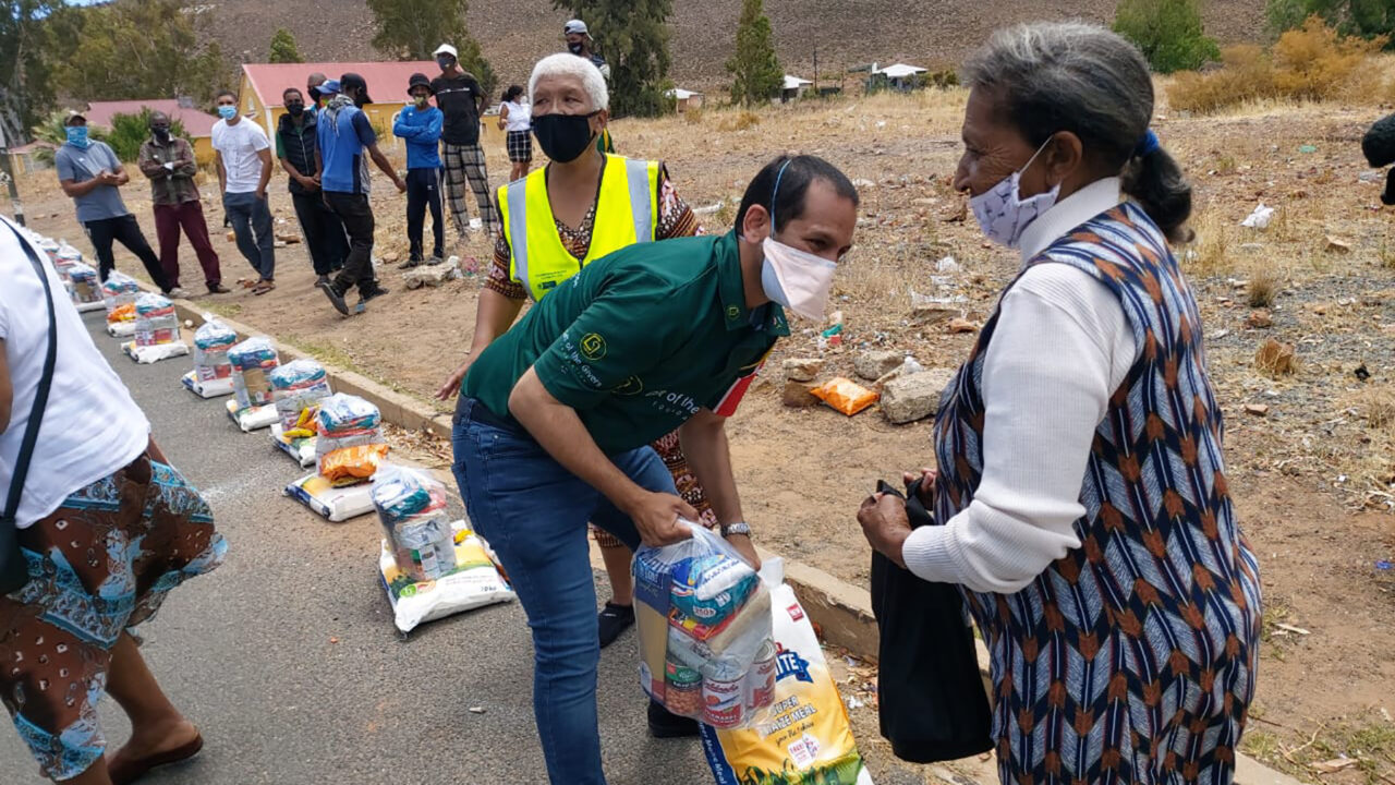 Gift of the Givers staff distribute food and essentials during Covid-19. (Courtesy photo)