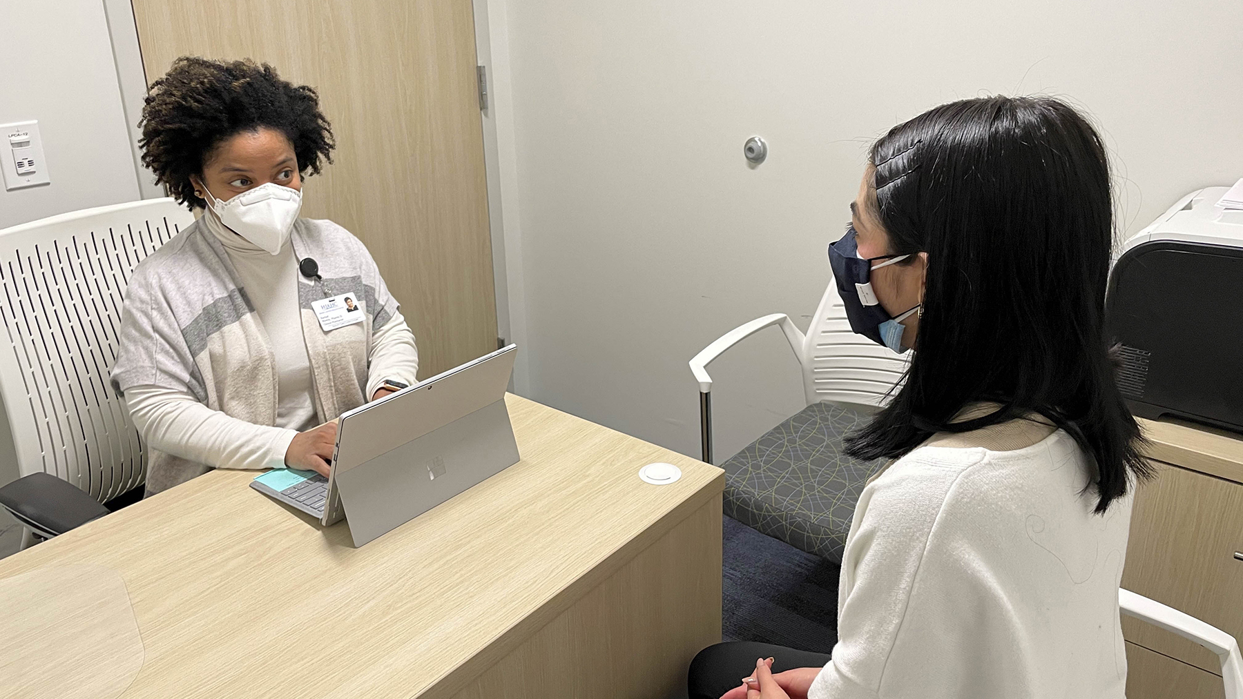 Transitions of Care pharmacist Rachel Rivera in consultation. (Photo courtesy of Henry J. Austin Health Center)