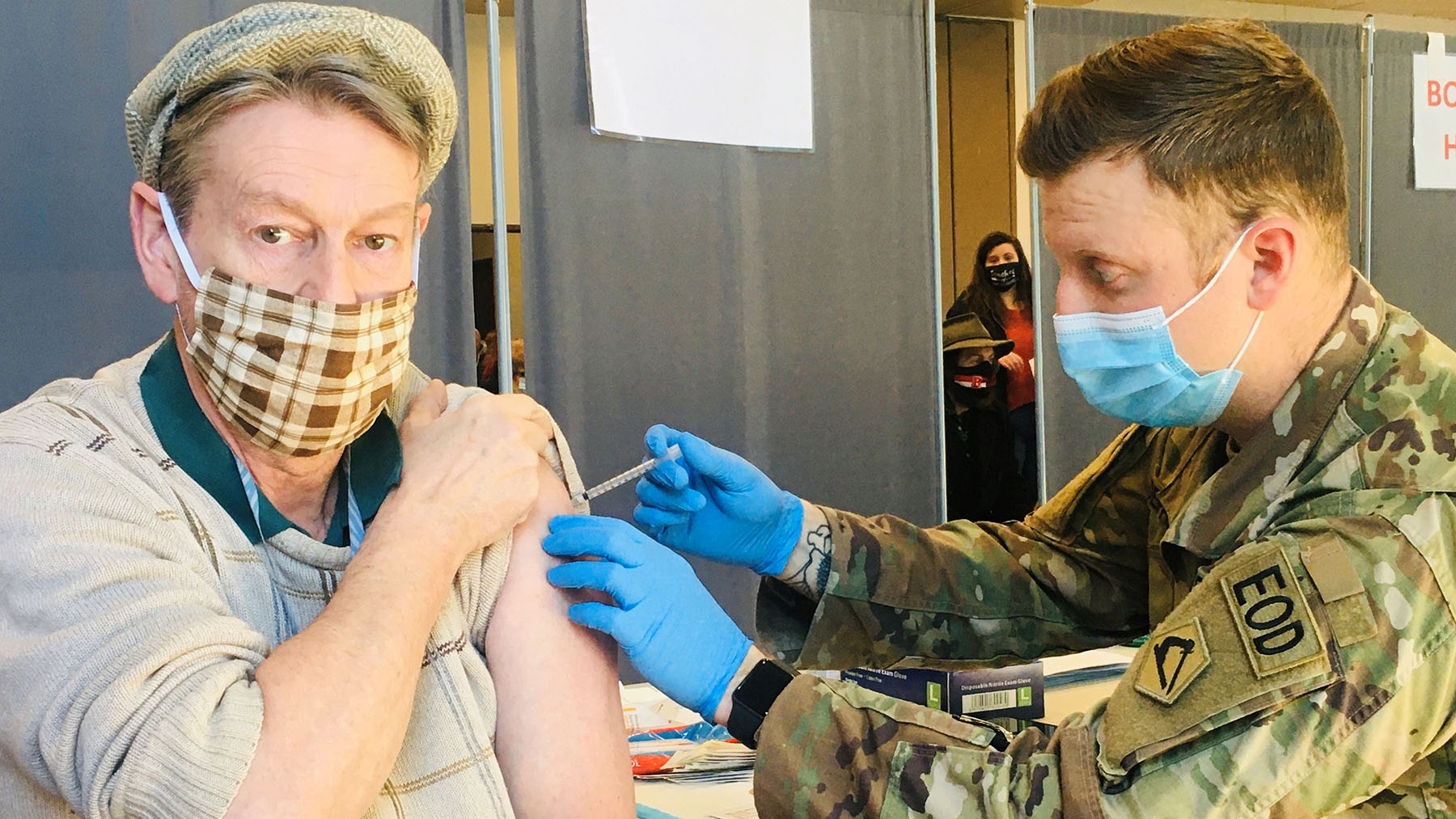 A member of the National Guard vaccinates a patient at a Brockton Neighborhood Health Center clinic. (Photo courtesy of Brockton Neighborhood Health Center)