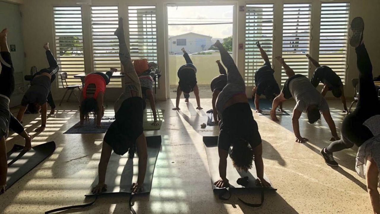 Puerto Ricans participate in a yoga session. Basic yoga is one of the core techniques the Center teaches. (Photo courtesy of the Center for Mind-Body Medicine)