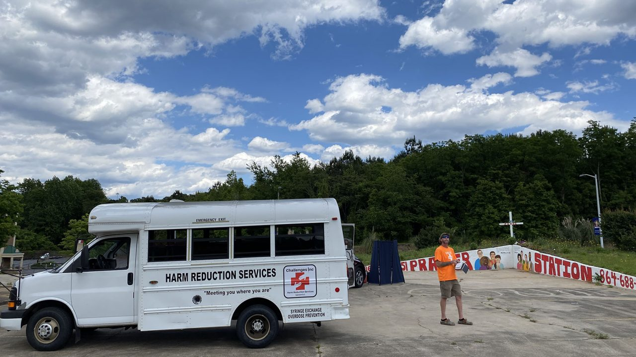 A Challenges, Inc. volunteer sets up a mobile site to distribute naloxone and clean supplies to drug users in South Carolina. (photo courtesy of Challenges, Inc.)