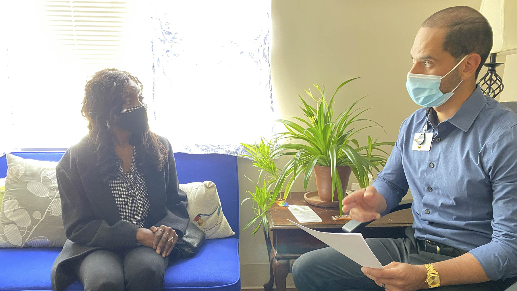 Carlos Leon meets with a patient enrolled in Westside Family Healthcare's HCV treatment program. (Photo courtesy of Westside Family Healthcare)