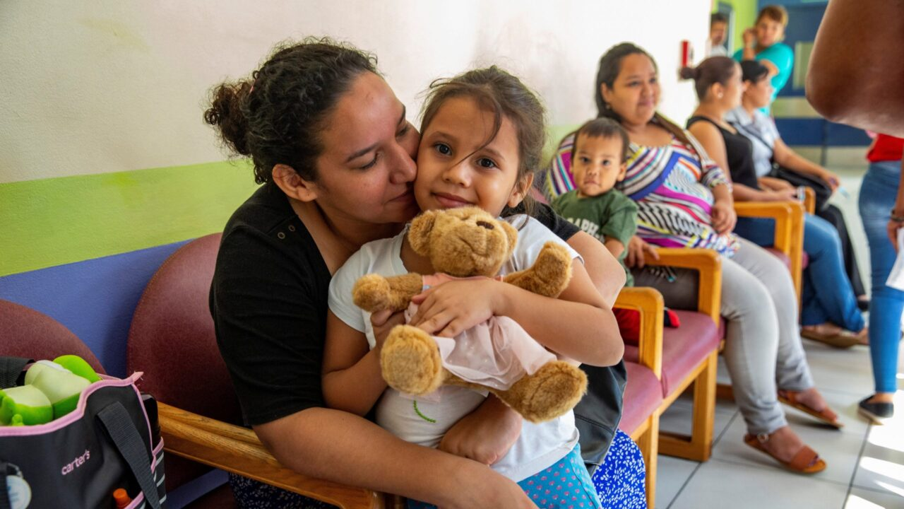 A patient and her caregiver in the waiting room of Ruth Paz Hospital in San Pedro Sula, Honduras. The hospital provides charitable care for pediatric patients, and Direct Relief shipped more than $961,000 worth of medical aid to the hospital over the past week. (Photo by Francesca Volpi for Direct Relief)