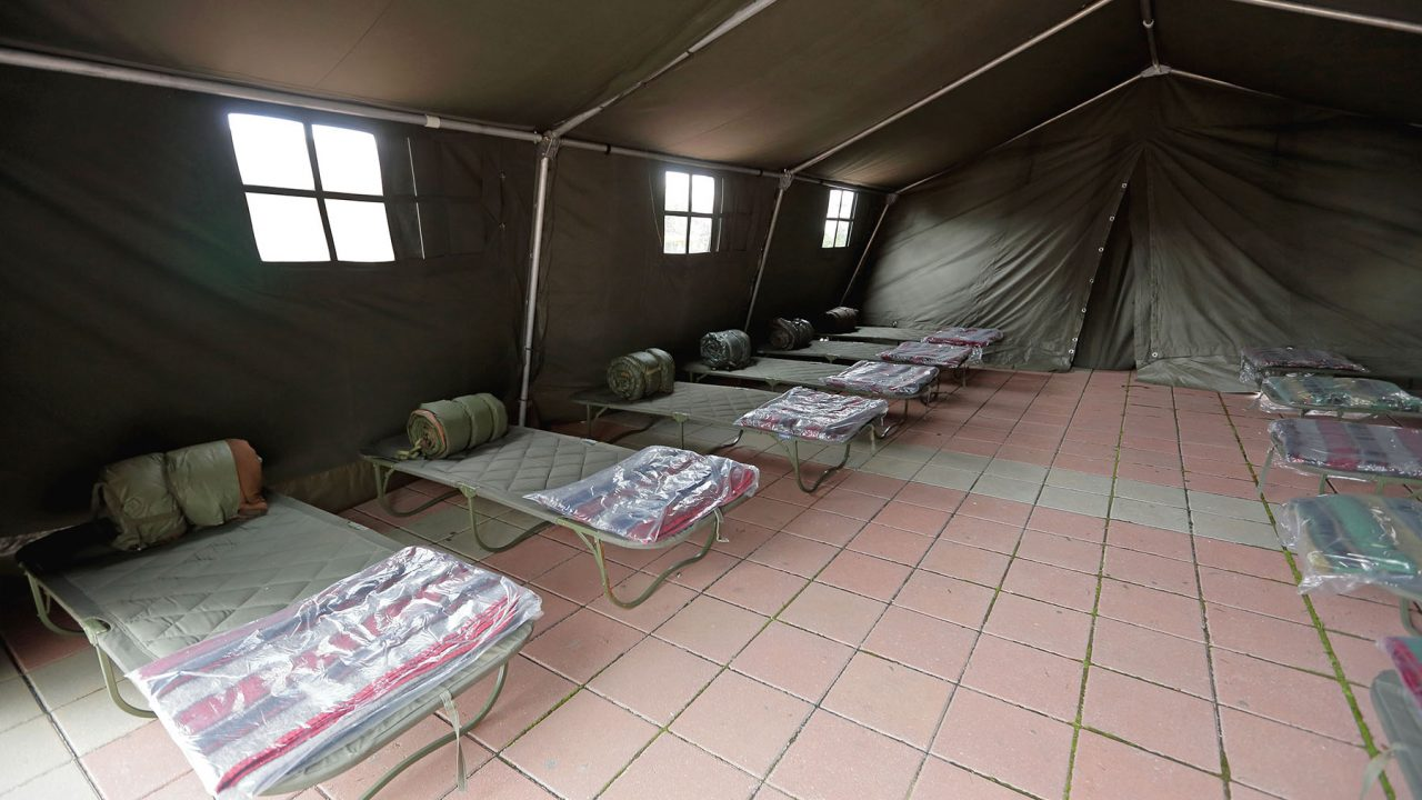 An emergency tent shelter for disaster victims. (Adobe Stock)