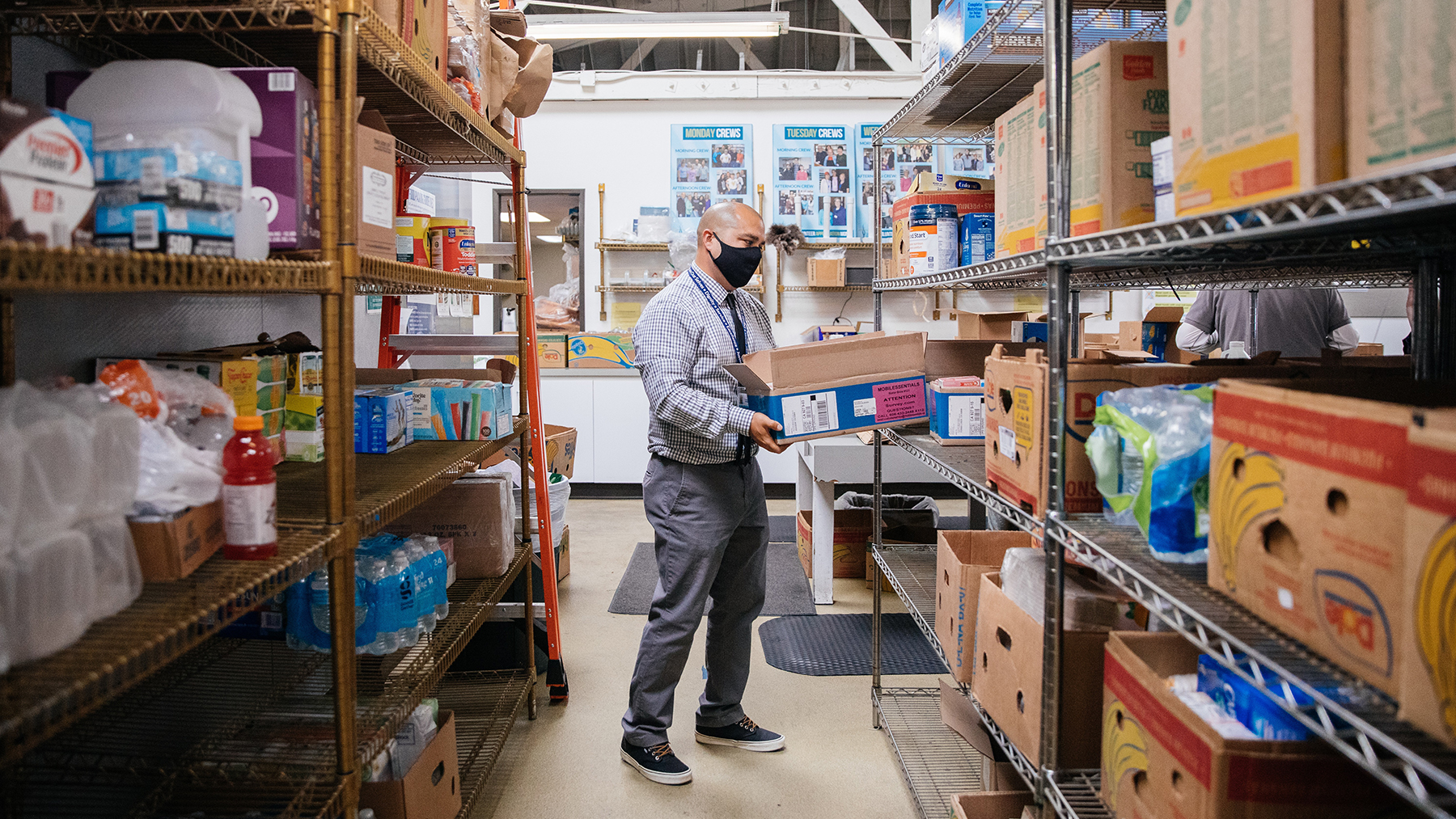 Fernando Gallegos, community health worker and pharmacy technician at Share Our Selves in Costa Mesa, CA, where donated food is repackaged and served to those in need. (Photo by Donnie Lloyd Hedden Jr. for Direct Relief)