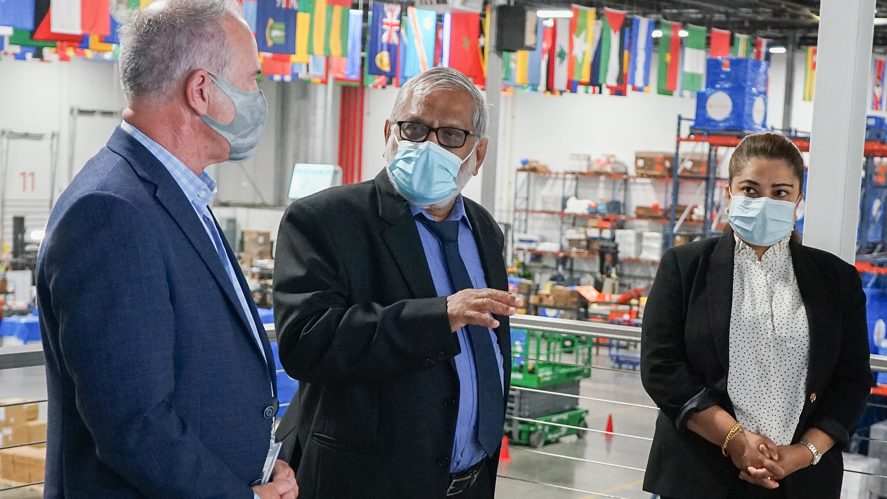 Honorable Dr. Lalith Priyalal Chandradasa, Consul General of Sri Lanka, (center) speaks with Direct Relief CEO Thomas Tighe and Aruni Boteju during a visit to Direct Relief's Santa Barbara headquarters on July 19, 2021. (Maeve O'Connor/Direct Relief)