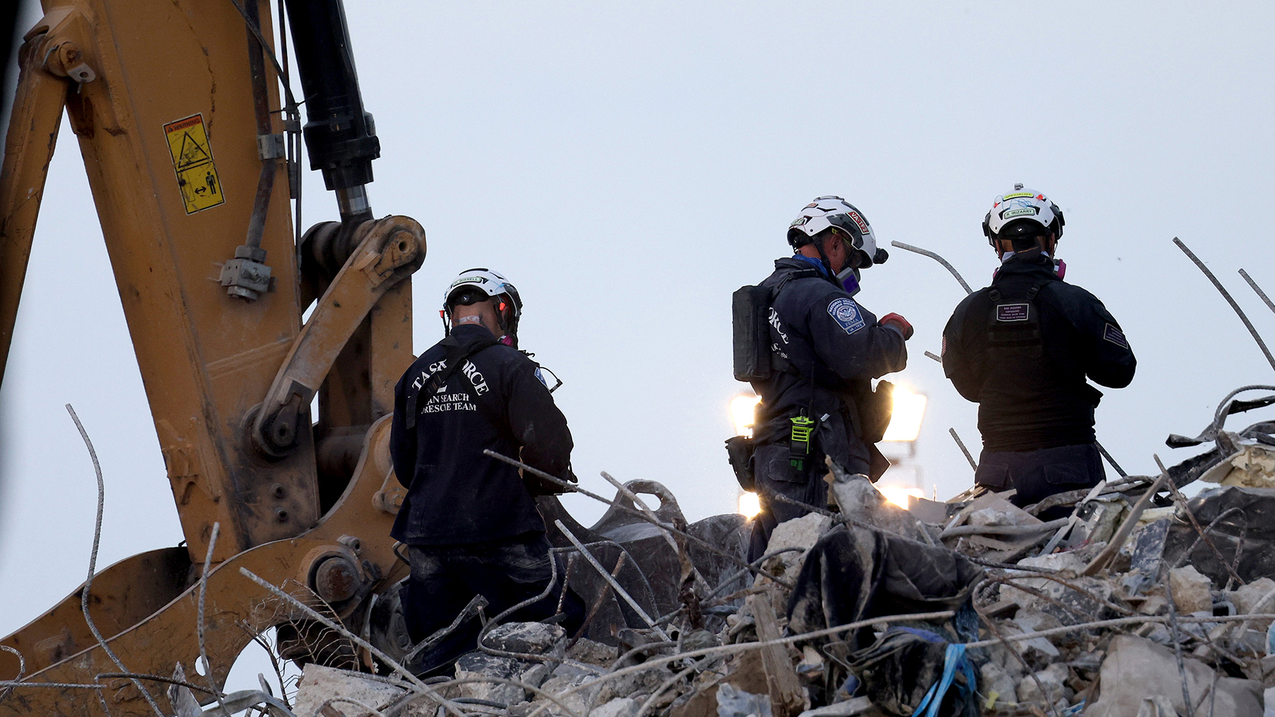 Search and rescue workers oversee an excavator dig through the rubble of the collapsed 12-story Champlain Towers South condo building on July 09, 2021 in Surfside, Florida. (Photo by Anna Moneymaker/Getty Images)