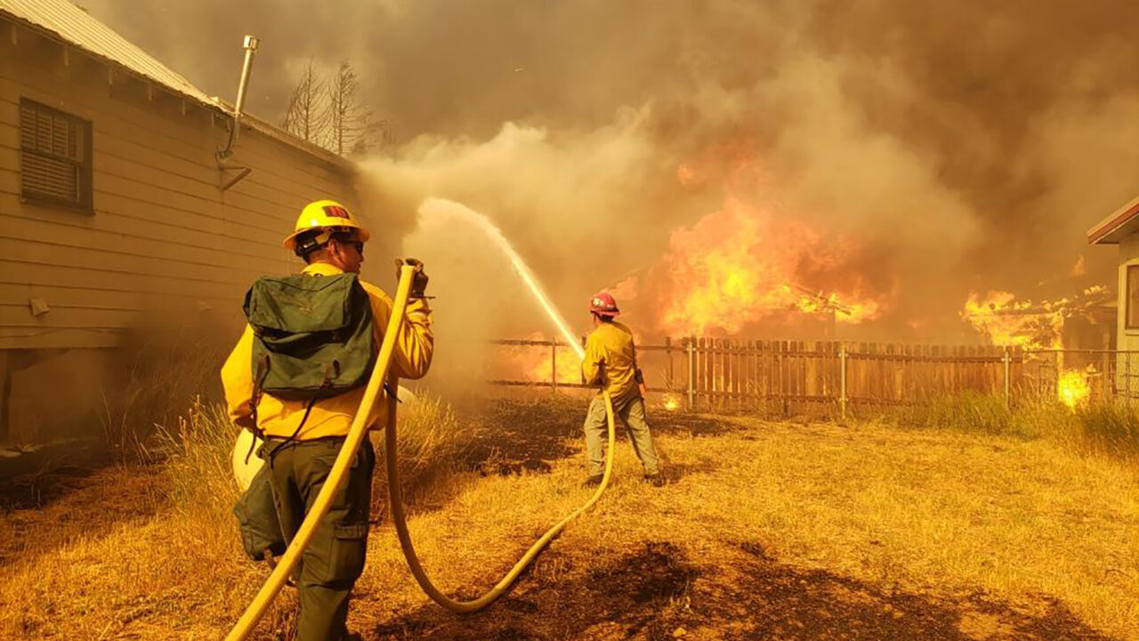 Firefighters battle the Dixie Fire in Greenville, California on August 4, 2021. (Lassen National Forest Service)