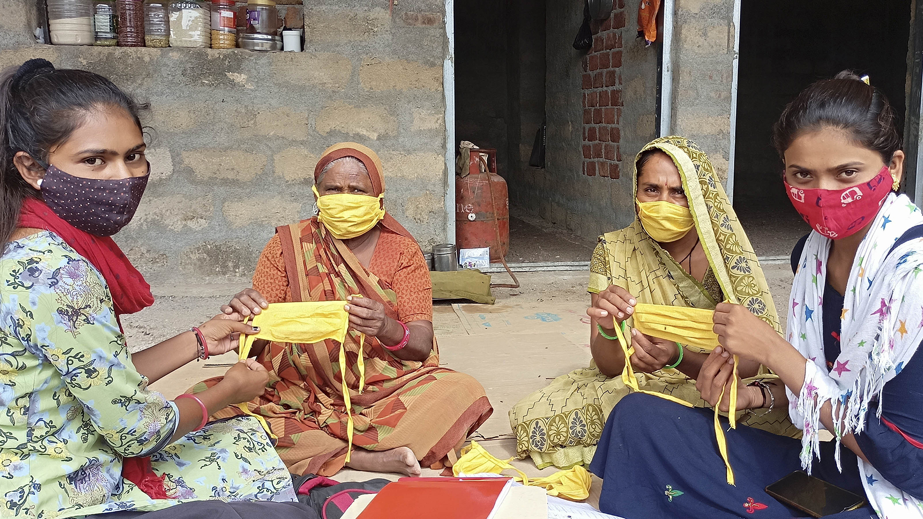 SEWA members craft face coverings for distribution in their communities. (Photo courtesy of SEWA)