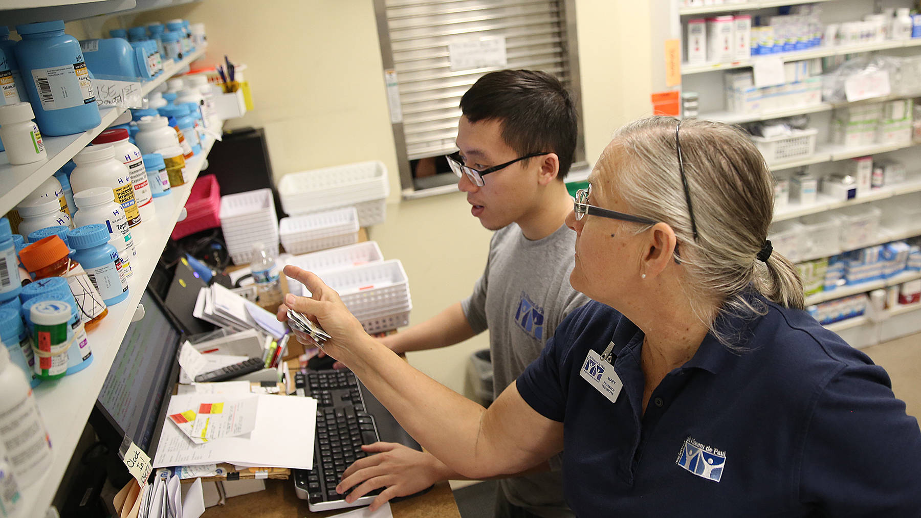 Pharmacists fill prescriptions at St. Vincent de Paul Charitable Pharmacy in Cincinnati, Ohio. (File photo courtesy of SVDP)