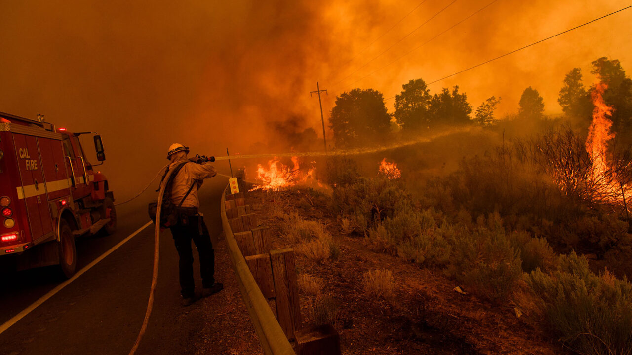 Cal Fire firefighters try to contain the Dixie Fire from spotting across Highway 395 on August 17, 2021 near Milford, California. (Patrick T. Fallon/AFP via Getty Images)
