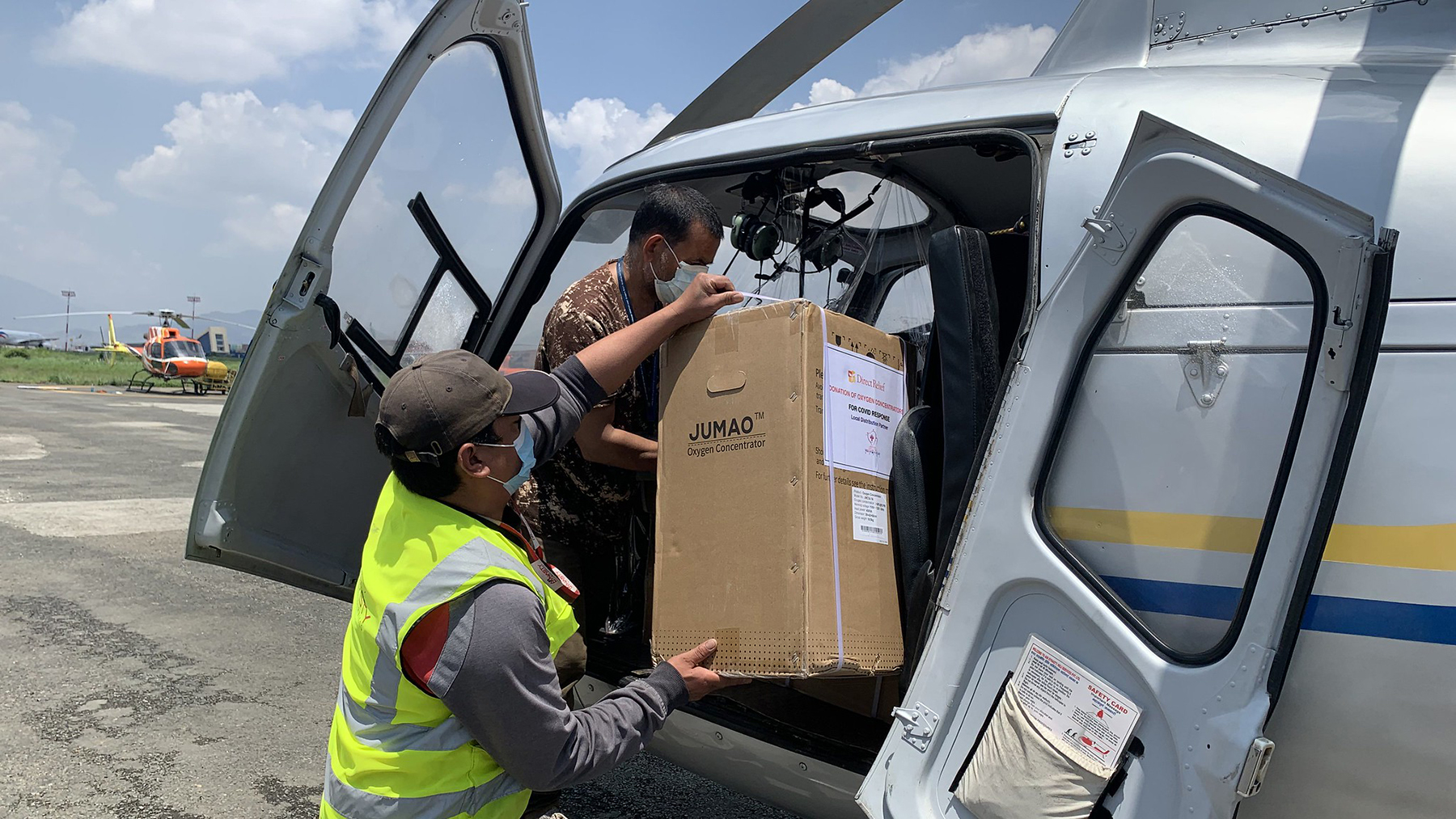 Oxygen concentrators from Direct Relief are loaded into helicopters for delivery to remote communities in the Himalayas. The concentrators went to NGO Mountain Heart Nepal, which support medical care in rural communities. (Mountain Heart Nepal photo)