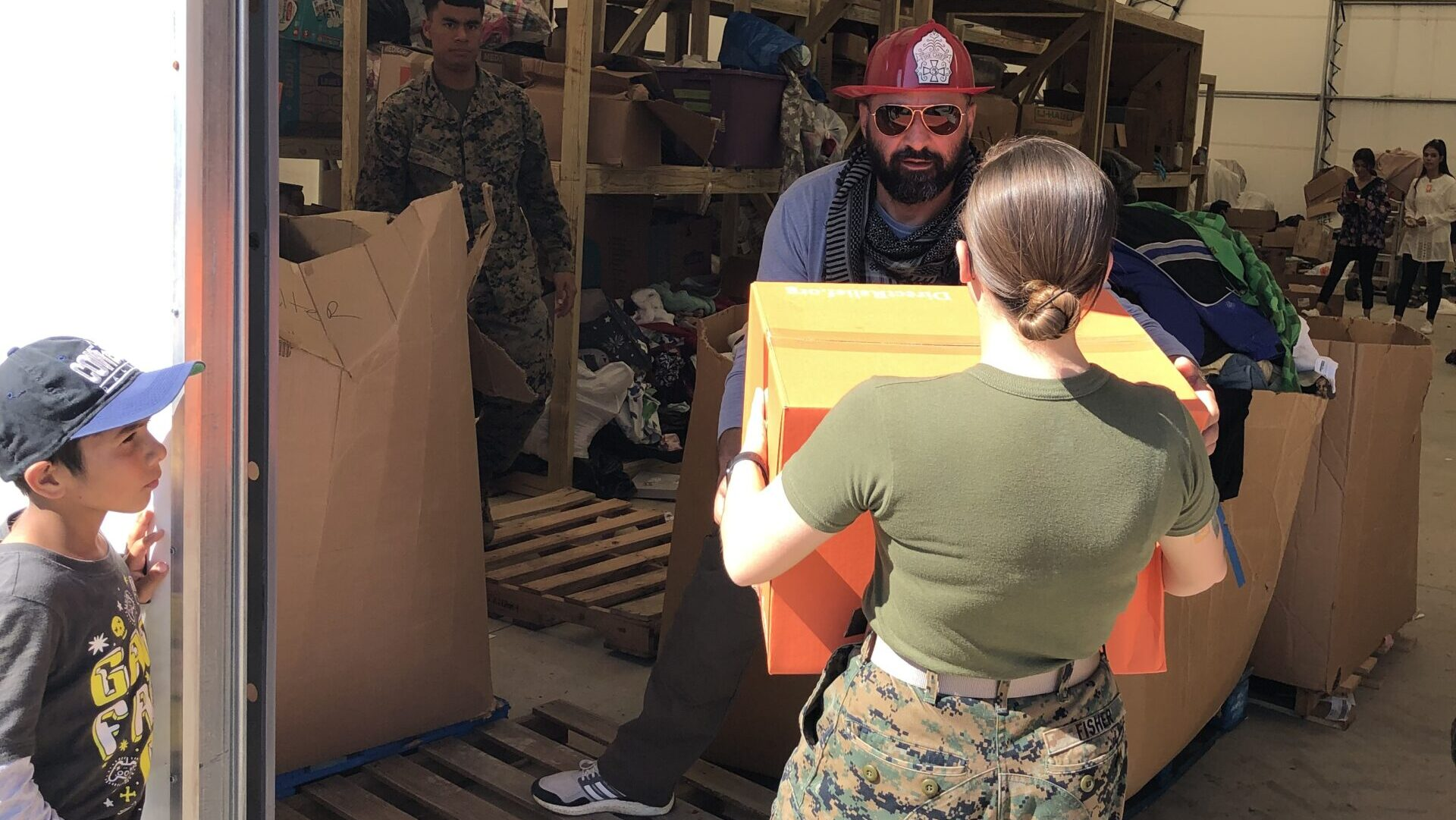 U.S. Marines receive donated supplies for Afghan refugees on Sep. 30, 2021 at Marine Corps Base Quantico in Virginia. (Photo Courtesy of Natalie Trogus)