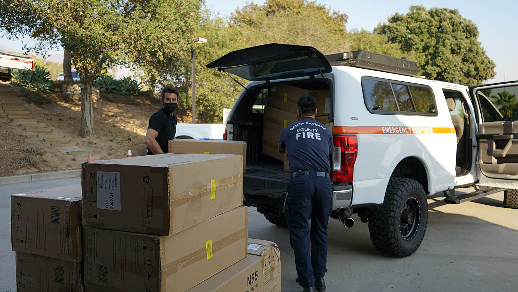 Direct Relief staff deliver N95 masks and eye medications to the Santa Barbara County Fire Department on Oct. 13, 2021,  to support their efforts to quell the Alisal Fire. (Amarica Rafanelli/Direct Relief)