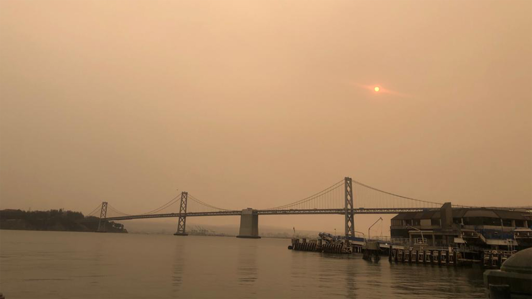 Smoky skies above the Golden Gate Bridge in San Francisco during an outbreak of wildfires in September 2020. (Kaitlyn Frysztak/Direct Relief)