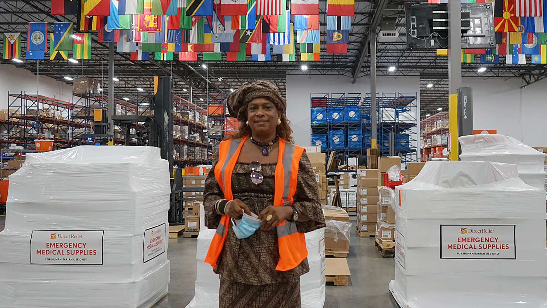 Sierra Leone's Honorary Consul Isatu Timbo visits Direct Relief's headquarters on August 14, 2020, as 16 pallets of personal protective gear and emergency medical supplies were prepared for shipment to Sierra Leone in response to Covid-19. (Amarica Rafanelli/Direct Relief)