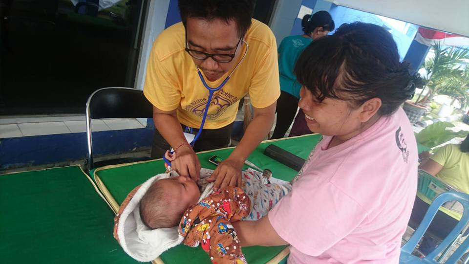 Healthcare providers with Bumi Sehat Foundation see the smallest patients on Oct. 16, 2018, at temporary clinic set up in Palu, Indonesia, to treat people displaced by last month's devastating earthquake and tsunami.  (Photo courtesy of Bumi Sehat Foundation)