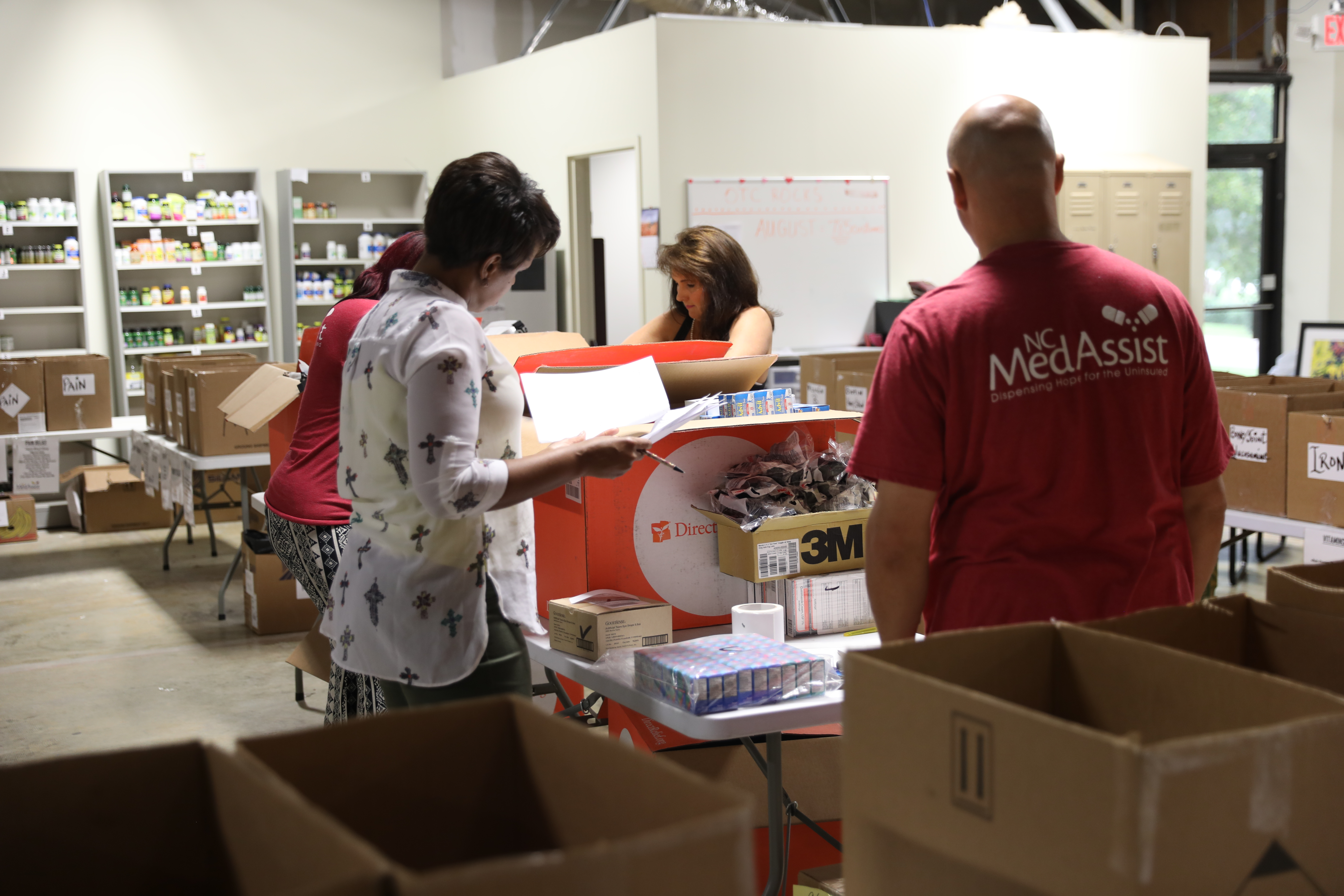 Staff from NC MedAssist in Charlotte inventoried medicines from Direct Relief on Friday. Many health centers and clinics are assessing the damage from Hurricane Florence to determine how to best serve patients displaced from wide-spread evacuations.  (Photo by Mark Semegen for Direct Relief)