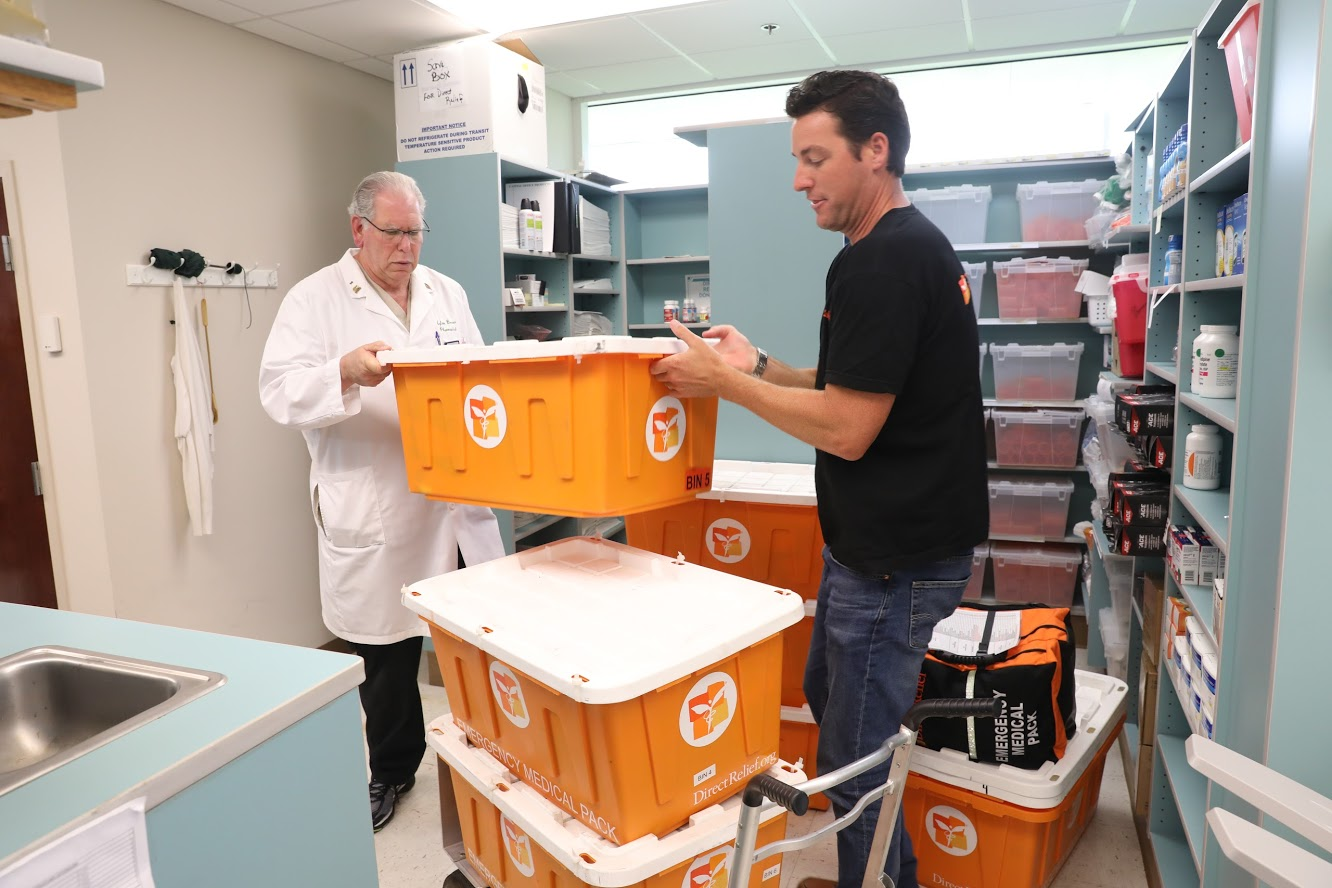 Direct Relief's Andrew MacCalla delivers medicine to the pharmacy at the Central Florida Family Health Center in advance of Hurricane Irma making landfall. (Photo by Mark Semegen for Direct Relief)