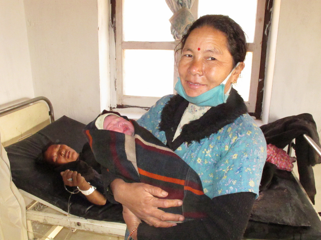 A skilled birth attendant with One Heart World-Wide Nepal smiles after a safe delivery.
