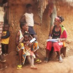 A frontline health worker with Tiyatien Health conducts a health survey with a family. Photo courtesy of Tiyatien Health.