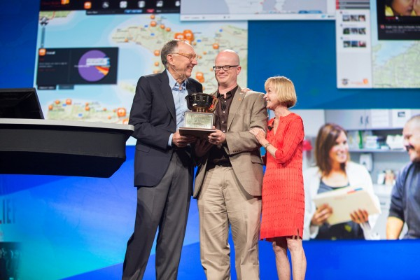 Esri President, Jack Dangermond, presents the President's award to Direct Relief board member, Dorothy Largay, and me.