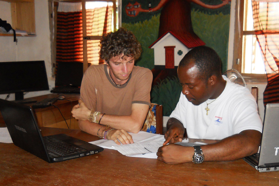 Avi Kenny (left) and Thomas Griffiths (right) conduct data analysis for the first stage of Last Mile Health's targeted efforts to reduce childhood pneumonia.
