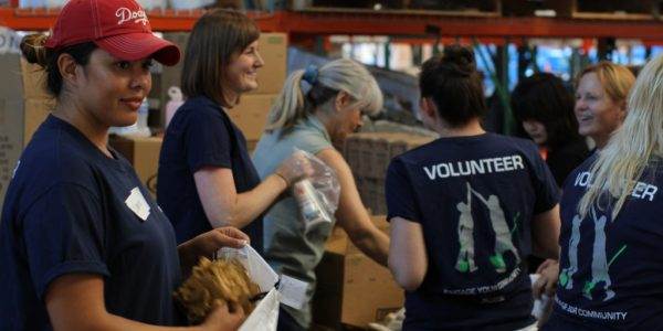 Volunteers Organize Care Packs for Neighbors in Need