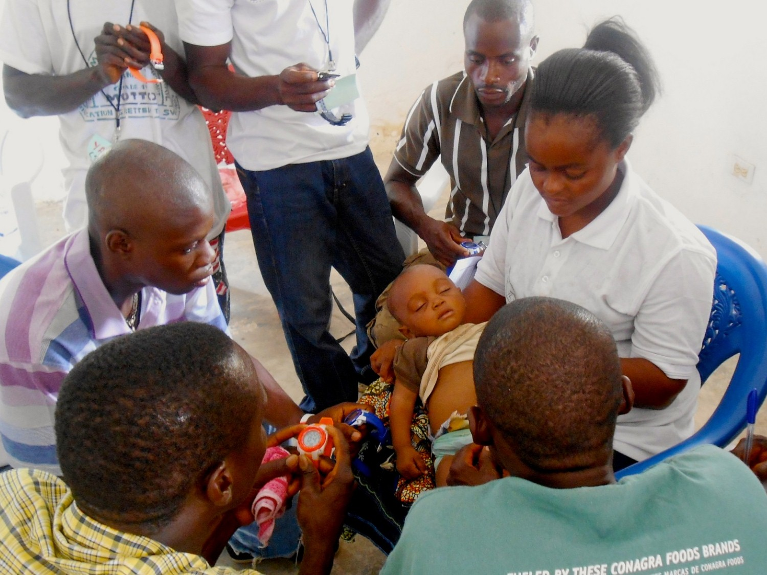 Medical workers assess a child's health during training. Photo courtesy of Last Mile Health.