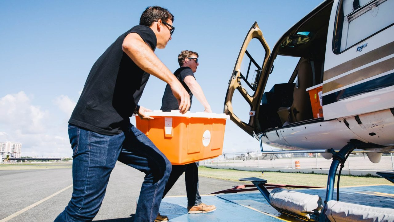 Direct Relief staff load critical medicines and supplies on to a helicopter in San Juan on Dec. 18, 2017. The medicines went to Health ProMed Health Center on the island of Vieques, which was hard-hit by Hurricane Maria. (Photo by Donnie Hedden for Direct Relief)