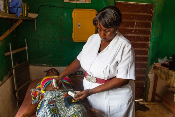 A midwife in Sierra Leone using equipment supplied by Direct Relief