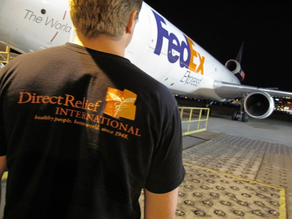 DRI staff and FedEx Plane