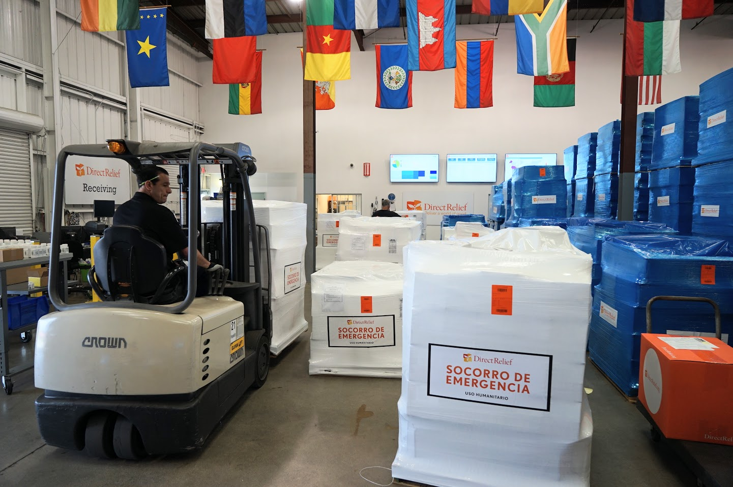 Emergency aid for Peru is staged and shipped from Direct Relief's Goleta warehouse on Mar. 21. (Photo by Bryn Blanks/Direct Relief)