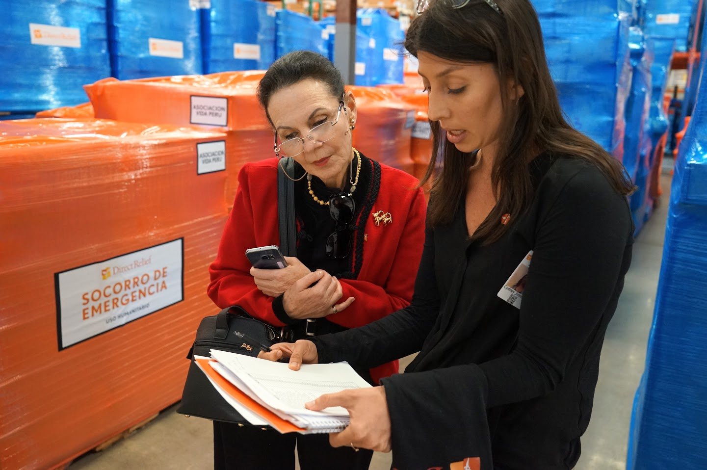 Ambassador Liliana Tamara Cino de Silva, Consul General of Peru in Los Angeles looks over shipments with Latin America Program Manager Cydney Justman at the Goleta warehouse Friday. (Photo by Lara Cooper/Direct Relief)