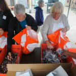 Direct Relief volunteers fill personal hygiene packs on Tuesday for Hurricane Matthew victims. Over 3,000 kits will go to those who have been displaced by the storm.